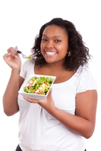 Eating several smaller, healthier meals daily - combined with regular exercise - should help you meet your goal.