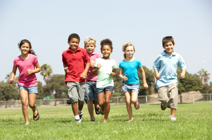 Group Of Children Running In Park